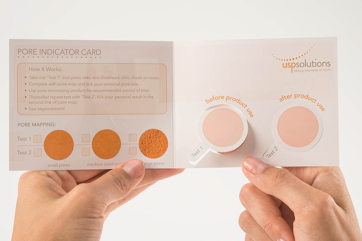 Pore Indicator Test - Pore Indicator Card - Open and held by two hands | USP Solutions