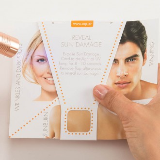 Reveal Sun Damage Tool - Face of Woman in UV Light | USP Solutions